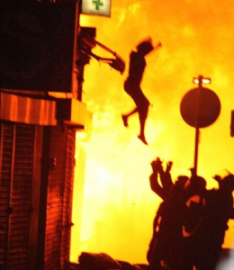 London Riots Woman Jumping